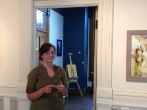 artist Julie Khyler in front of her studio at Gallery One.