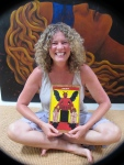 Lisa de St. Croix smiling with the Devil from her forthcoming de St. Croix Tarot deck
