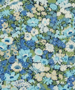 a lighter blue, and more densely flowered, but this is one of Liberty's printed fabrics